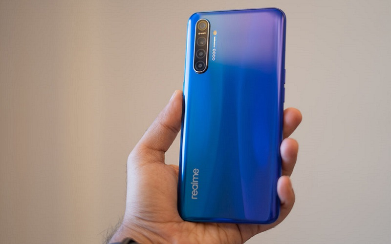 Realme-XT-in-hand-with-back-panel-and-gradient-1200x675
